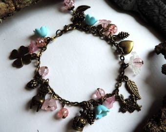 """The world of Alice"" bronze bracelet: rabbit, heart, Crown, Chair, leaves, pinecones and pine, clover, bronze leaves, beads"