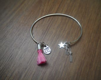 Silver bracelet with charms and tassel