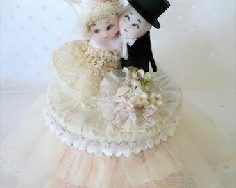 Vintage Kewpie bride and groom wedding cake topper
