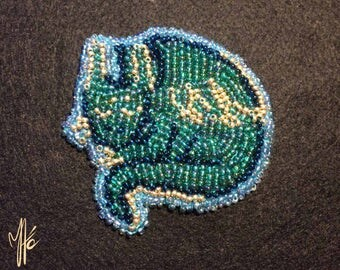 Emerald dragon brooch
