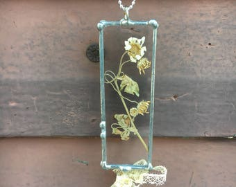 Romantic glass pendant necklace designed with little daisies and lace bow.