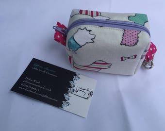 Handmade Dog Bag Holder in dog fabric, Doggy Bag, can be used for dog treats, poo bags, handy keyfob, clips on to bag, keys, lead