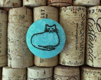 Fabric-covered button pin - embroidered cat