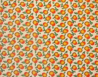 COTTON FABRIC HAS FLOWERS YELLOW AND ORANGE