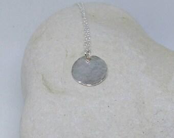 Hammered sterling silver disk pendant