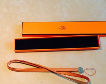 Hermes - natural leather cords and metal