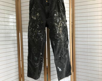 36x30 black Carhartt pant. paint splattered. double front work pant. washed and worn in for comfort and totally rad art bum style.