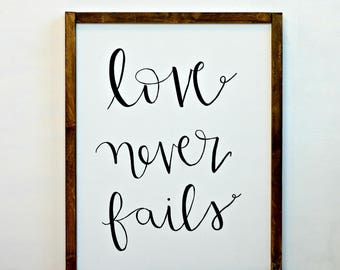 Love Never Fails Wood Framed Canvas