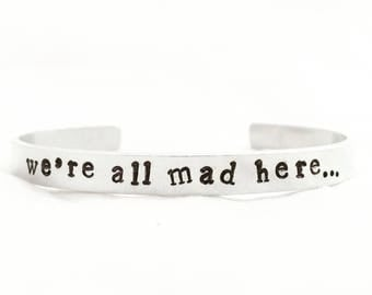 We're all mad here bracelet. Alice in Wonderland cuff. Handstamped book quote jewlery.