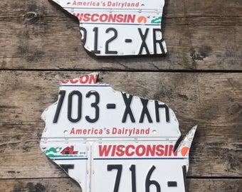Wisconsin license plate shape. Wall hang or shelf.