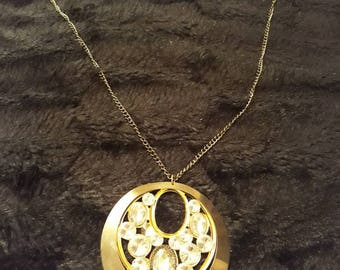 Long Gold Coloured Pendant Necklace With Crystal Design Centre Piece