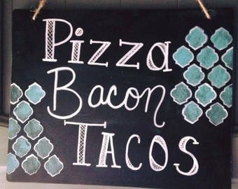 Pizza bacon tacos sign
