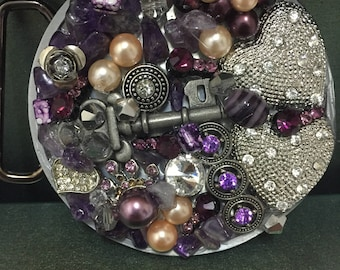 Purple and silver belt buckle