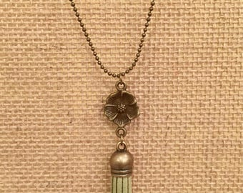 Little girls moss green mini tassel necklace with small floral accent in antique brass