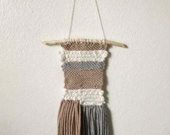 Neutral color woven wall hanging