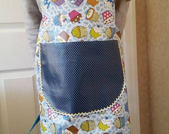 Oil cloth kids apron with yellow and blue trim on pocket. Water proof upvc