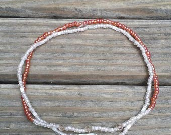Coral and cream anklet set.