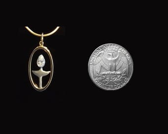 14K White and Yellow Gold UU Pendant set with a .30 ct Pear-Shaped Diamond
