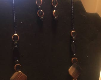 Blue and gold beaded necklace and earrings