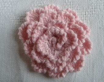 large flower crocheted in soft wool