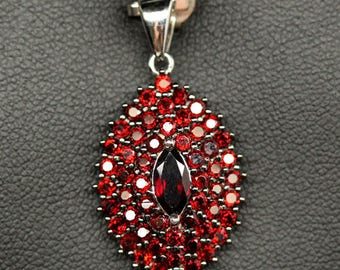 Pendant in 925 silver plated white gold red garnets