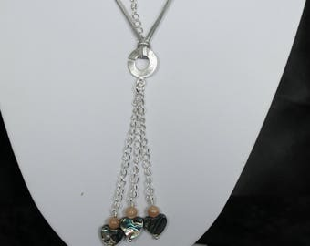 Long necklace of silver suede cord with silver plate pendant with peach moonstone and paua shell