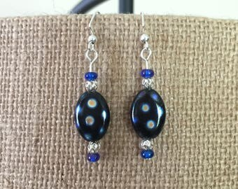 "Black oval w/ ""oil slick"" dots glass, silver filigree, & blue glass bead earrings"