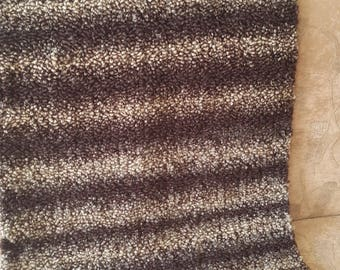 Very soft brown black striped knitted rug. 25 % wool. Handmade in EU.