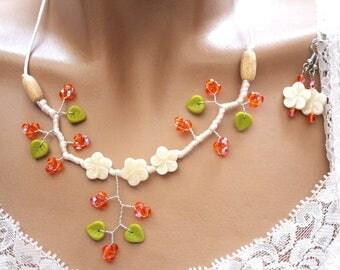 Orange and white floral adornment