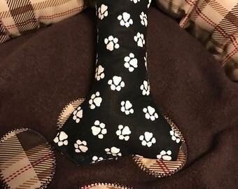 Dog toy squeaker bone shaped paw print