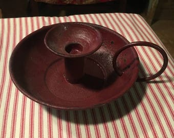 red tin candle holder