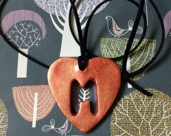 Heart-shaped, bronze and copper pendant
