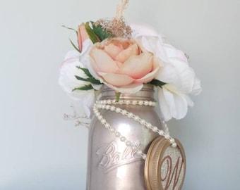 Mason jar floral arrangement centerpiece