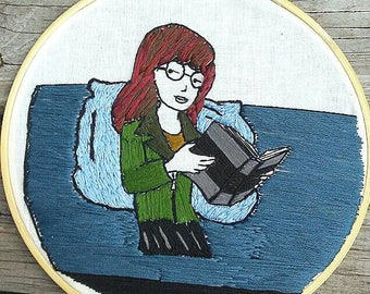 Daria reading on couch embroidery