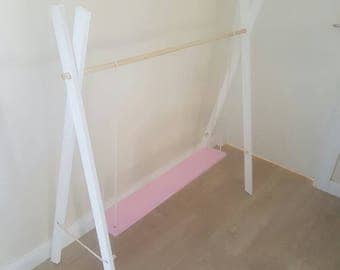 White and pink clothes rack