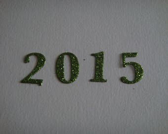 Cutting 2015 in green glitter cardstock for creation