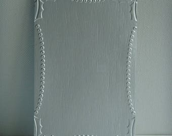 Cut 100% recycled brick embossed milk picture frame for creating Holly leaves