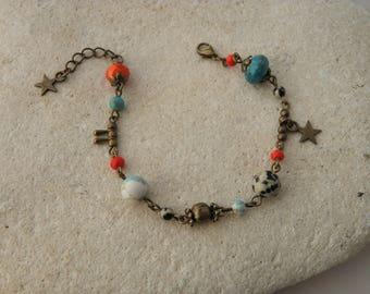 Bronze collection bracelet and 1 red and turquoise beads