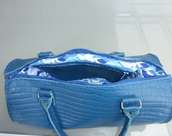 Leather blue duffel bag
