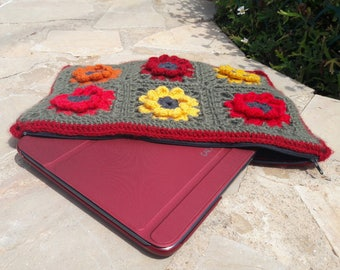 Cover of tablet or laptop crochet granny flowers red-orange-yellow green background