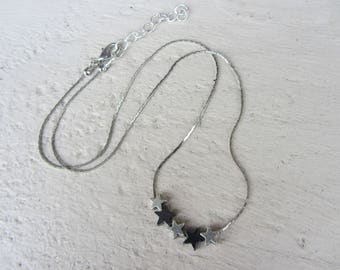 simple and elegant necklace with silver and hematite, serpentine chain in silver stars