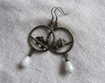 Earrings drop dangle bird in a bronze metal ring, white faceted glass