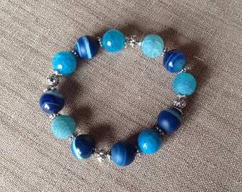 Blue agate and silver beads stretch bracelets.