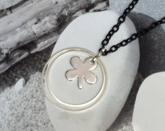Long pair of rings and a clover