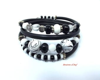 Black and white bracelet. Bracelet unique and original creation of clay polymer and pearls. Wraps around the wrist.