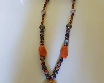 Orange and black beaded handmade necklace.