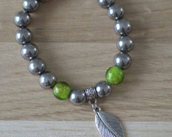 Bracelet beads silver glass beads in green and gold lampwork glass and leaf charm