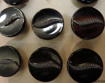 16  vintage buttons in glass