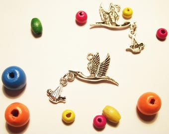 """silver metal 1 """"Stork and baby"""" charm"""