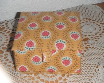 Box of cardboard and fabric lining